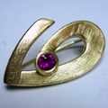 18ct Yellow Gold Brooch set with One Round Ruby made for a customers Ruby Wedding Anniversary